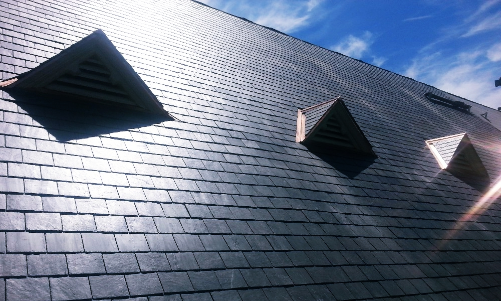 Slate Roofing Contractor Commercial Building in Kansas City Above All Construction 601 Avenida Cesar E Chavez Unit 244 Kansas City, MO 64108 (913) 298-6603 http://www.aboveallkc.com https://www.facebook.com/AboveAllConstructionLLC/