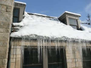 The Effect of Ice Dams on Your Roof and Gutters