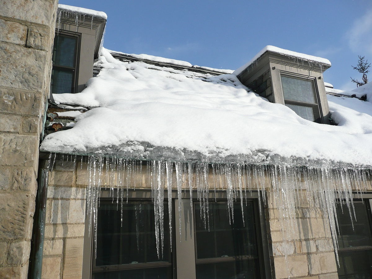 The Effect Of Ice Dams On Your Roof And Gutters Above